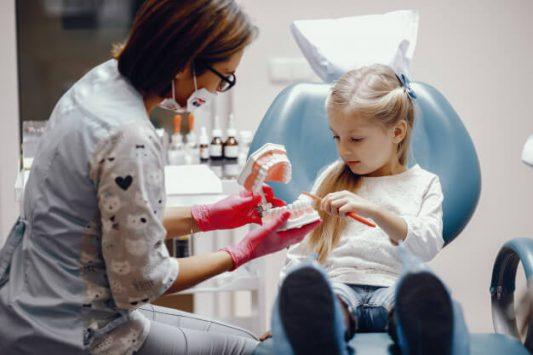 cute-little-girl-sitting-dentist-s-office_1157-19465-1-e1617782584304.jpg